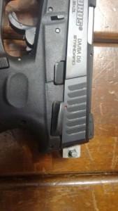 Pistola taurus com seletor de rajada